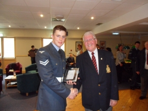Cpl King receiving the pewter photoframe